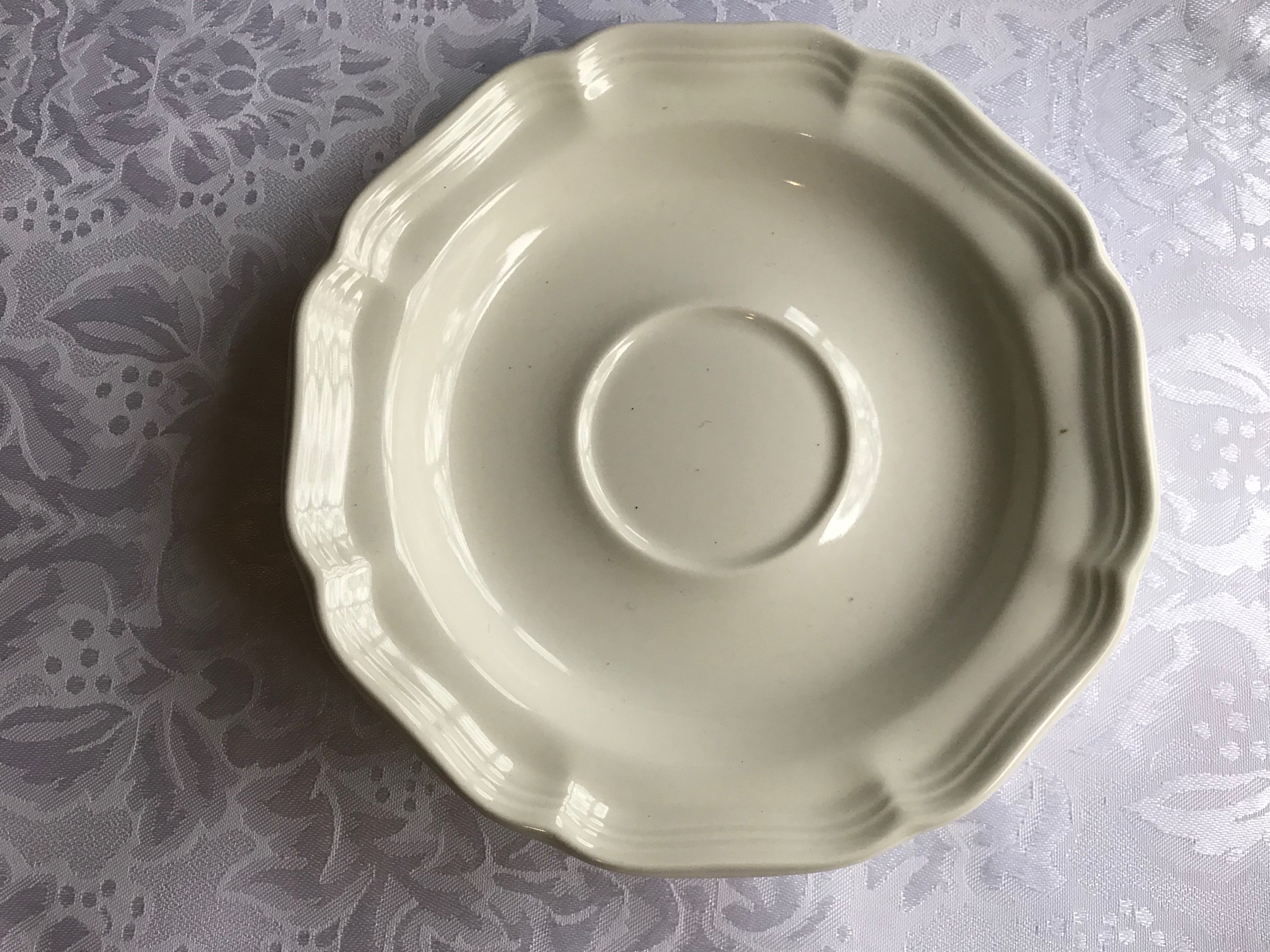 "Small White ""French Countryside"" Mikasa Saucer: 638 ppm Lead on the back logo."