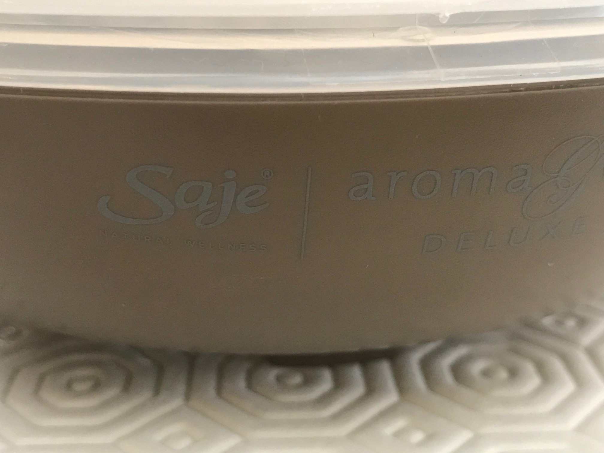 Brown Ceramic Saje Natural Wellness AromaGeni Deluxe Essential Oil Diffuser: 437,400 ppm Lead in center of inside of unit.