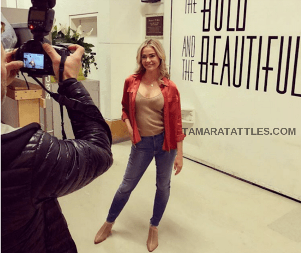 Denise Richards posing on set of The Bold and the Beautiful