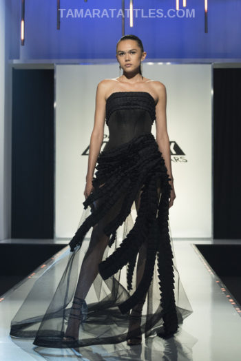 Irina's black gown with tailored ruffled bodice and sheer skirt