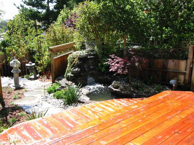 custom build cedar deck overlooking waterfall and koi pond