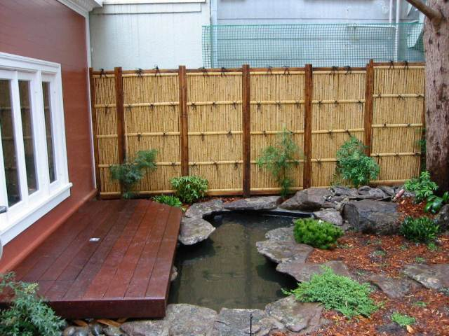 outdoor deck constructed over koi pond