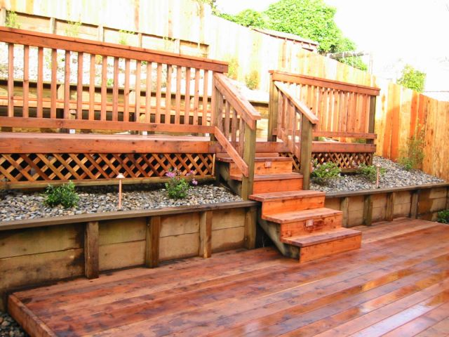 custom constructed wooden deck and patio with staircase