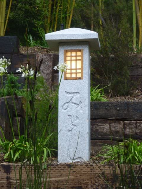 tall stone asian inspired outdoor lantern lighting