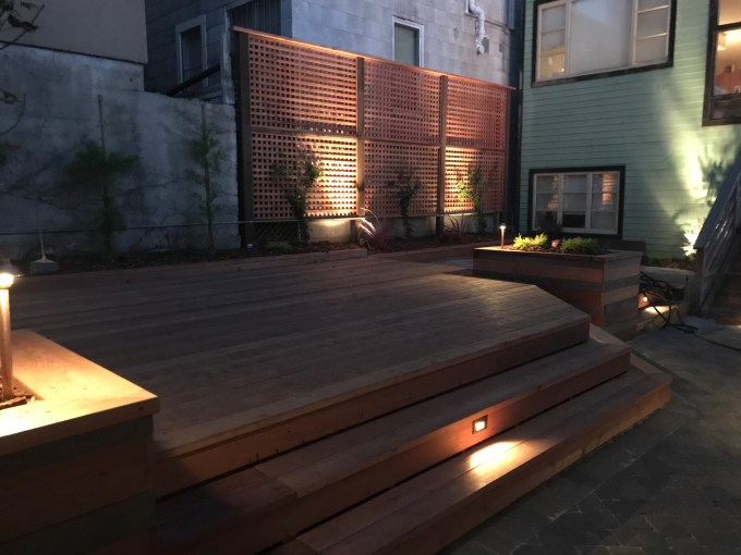 Backyard Landscape Project: New redwood deck with large planter boxes, step lights, path lights and uprights