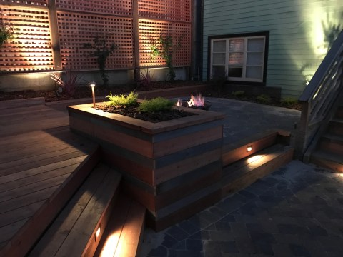 Backyard Landscape Project: Redwood lattice, decorative plants and backlighting