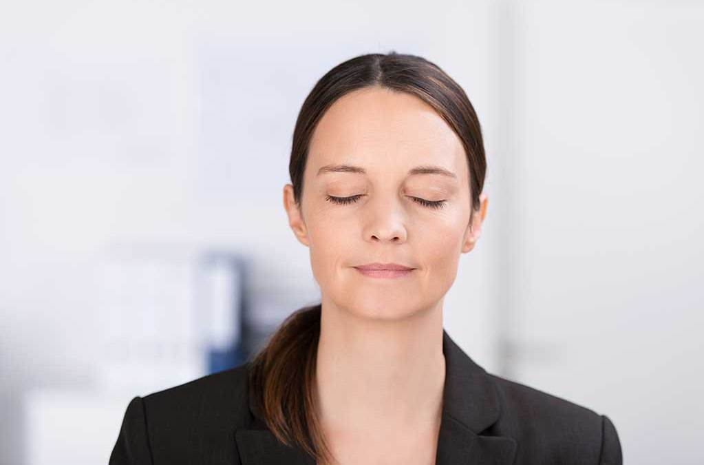 Young woman meditation in office