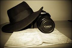 indiana jones hat, camera, map