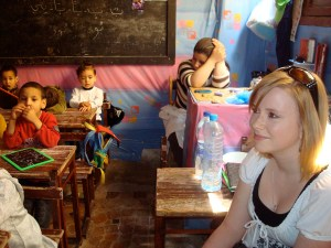 Kenzie listening to the kindergarteners