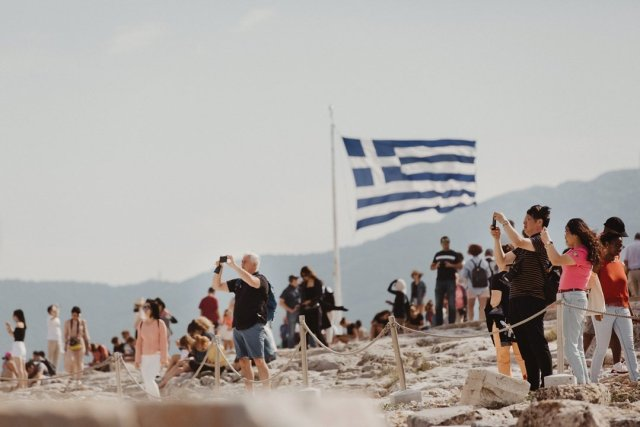 Greek flag high above in Acropolis in Athens Greece by Tami Keehn.