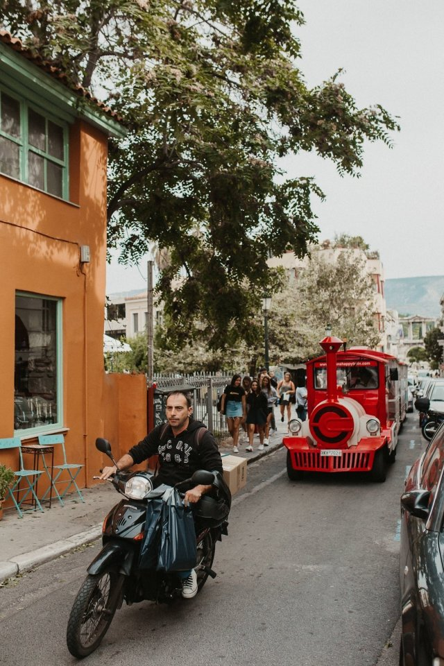 A motorcycle and train in the streets of Plaka in Athens Greece by Tami Keehn.