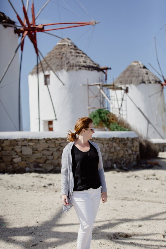 Portrait in front of the famous windmills in Mykonos Town, Greece by Tami Keehn