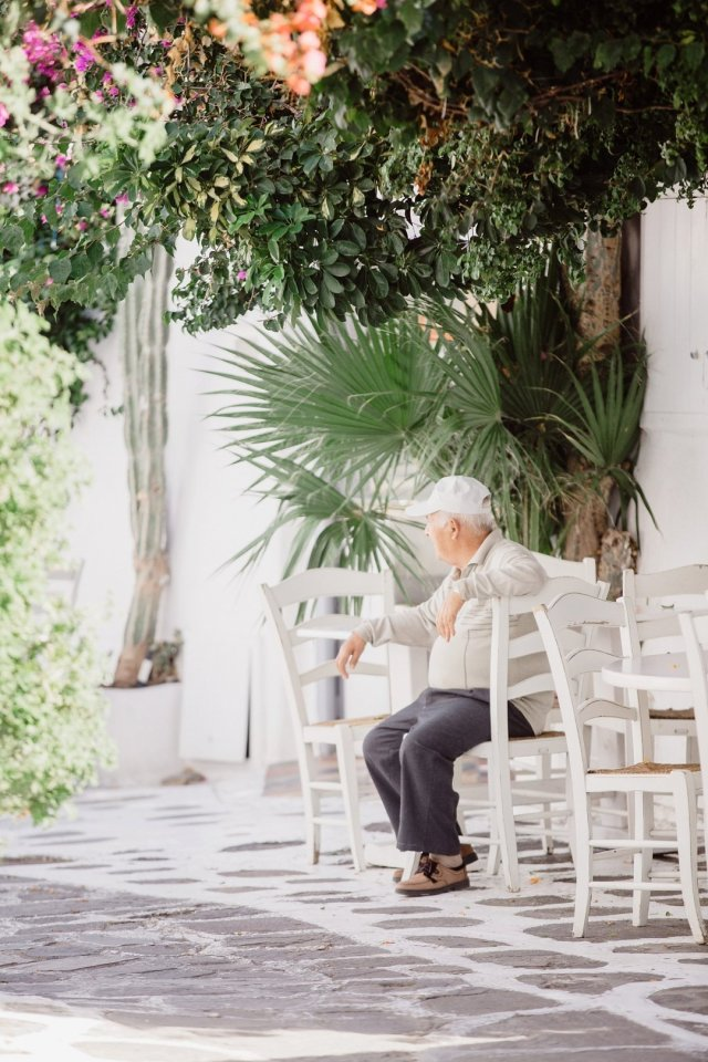 Old Man in Mykonos Town, Greece by Tami Keehn