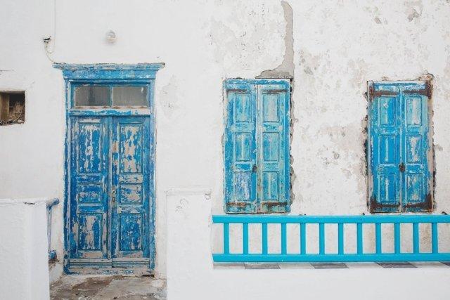 Blue doors and window panes in Mykonos Town, Greece by Tami Keehn