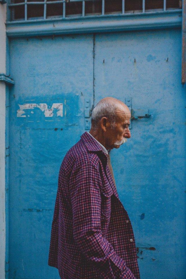 Old Greek man in Oía, Santorini Greece by Tami Keehn