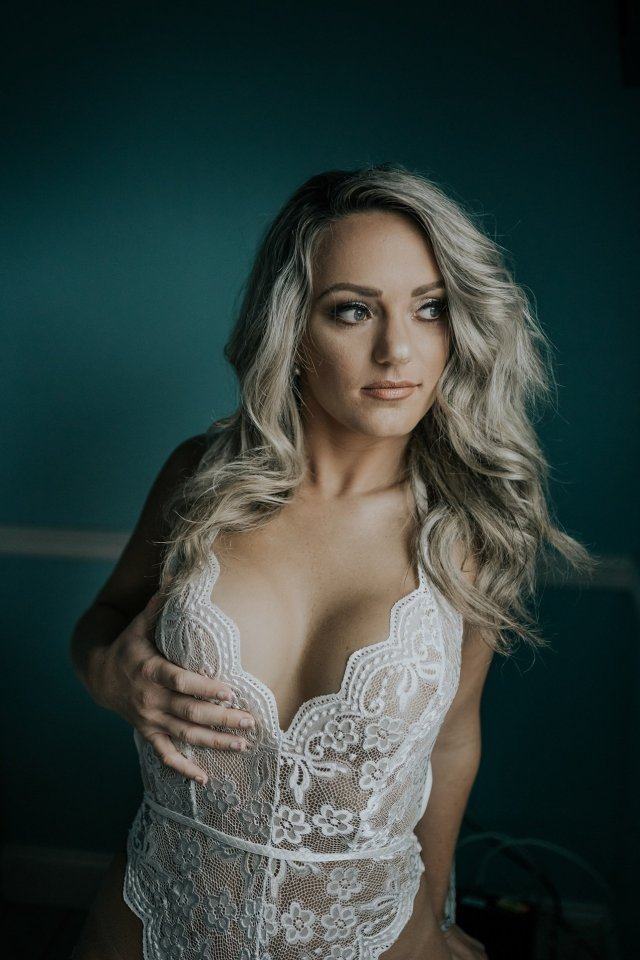 A blonde babe poses for boudoir photos during her bachelorette party in St Pete with photographer Tami Keehn.