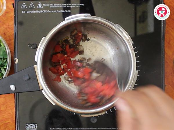 Add tomato and saute