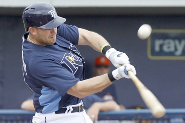 Evan Longoria hits a first inning single Tuesday in the Rays' spring training game against a split Astros squad in Port Charlotte.