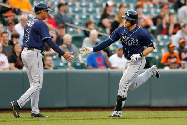 Third-base coach Tom Foley congratulates Evan Longoria, who hits one of the Rays' four solo homers, in the first inning. (Photo courtesy of Getty Images)