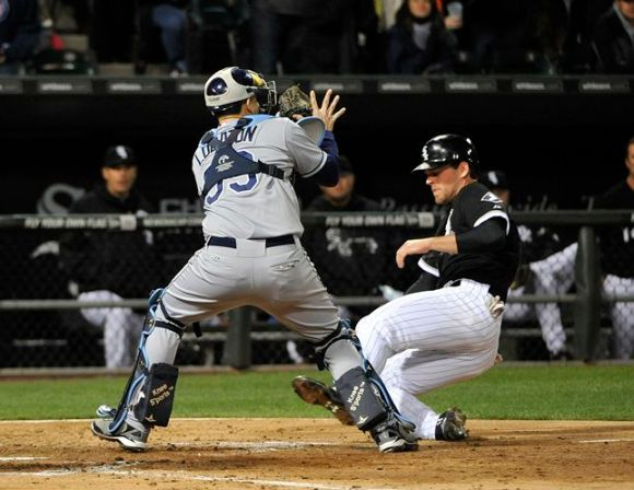 Jose Lobaton prepares to tag out the White Sox's Conor Gillaspie in the fourth inning. (Photo courtesy of Getty Images)