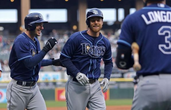 Ben Zobrist gets a pat on the back and a smile from Matt Joyce after hitting a two-run homer in the first inning. (Photo courtesy of Associated Press)