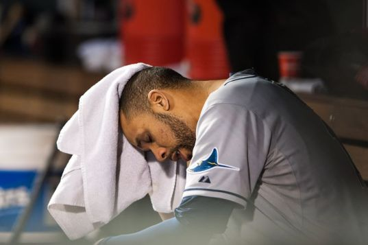 David Price sits in the dugout shortly after Nolan Arenado's grand slam ends his outing. Price falls to 1-3 with a 6.25 ERA. (Photo courtesy of Getty Images)
