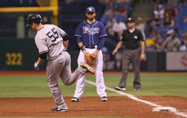 Lyle Overbay trots past Rays first baseman James Loney after putting the Yankees ahead 4-3 with a two-out home run in the 11th inning. (Daniel Wallace/Times)