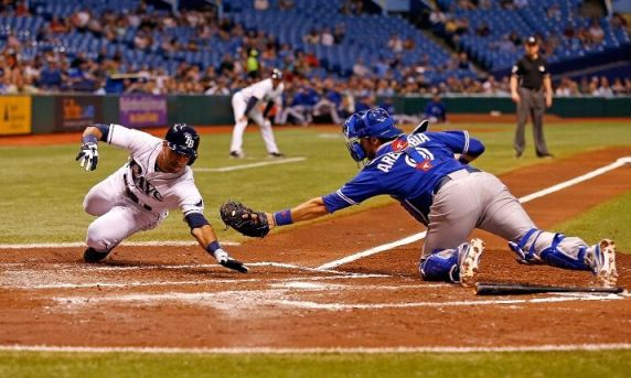 J.P. Arencibia stretches but does not initially tag Sean Rodriguez (Photo by J. Meric/Getty Images)