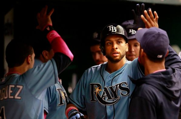 Tampa Bay Rays James Loney in congratulated in the dug out after hitting a home run to make the score 4 to 2 against the San Diego Padres during the 8th inning at Tropicana Field in St. Petersburg Sunday afternoon. (Photo courtesy of Dirk Shadd/Tampa Bay Times )
