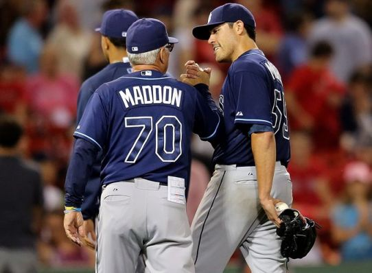 Matt Moore, right, gets a handshake from Rays manager Joe Maddon after pitching the first complete game of his career. (Photo courtesy of Getty Images)