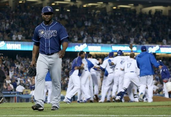 Fernando Rodney walks off the fielder after giving up four runs in the ninth inning to lose the game. The Dodgers won 7-6. (Photo courtesy of Stephen Dunn/Getty Images)