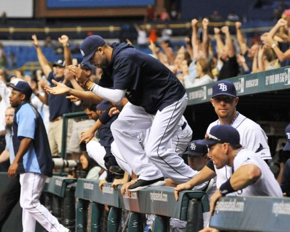 David Price jumps ove the dugout wall after the final out against the Boston Red Sox. (Photo by Al Messerschmidt/Getty Images)