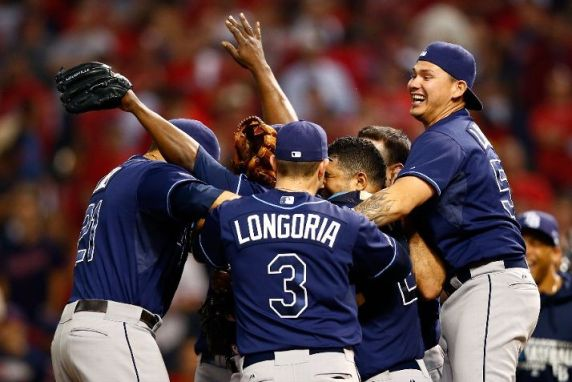 Evan Longoria celebrates with his teammates after defeating the Cleveland Indians in the American League Wild Card. (Photo by Jared Wickerham/Getty Images)