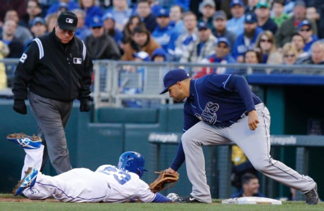 James Loney tags out Norichika Aoki on a pick-off play in the first inning of Tuesday night's game. Umpire Gerry Davis looks to make the call. (AP Photo/Orlin Wagner)