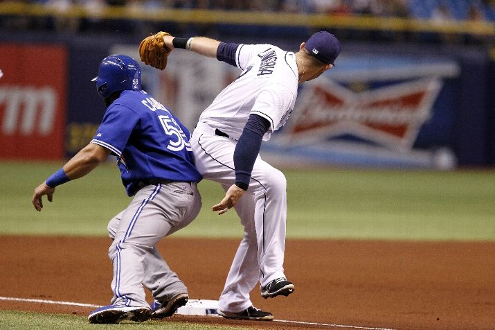 Evan Longoria beats Melky Cabrera to the bag for the out at third base after Dioner Navarro of the Toronto Blue Jays grounded to third to end the top of the first inning. (Photo by Brian Blanco/Getty Images)
