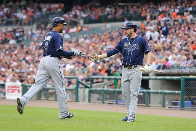 Desmond Jennings is congratulated by Matt Joyce after scoring on a single by Ben Zobrist (not pictured) during the first inning of the game against the Detroit Tigers. (Photo courtesy of Leon Halip/Getty Images)