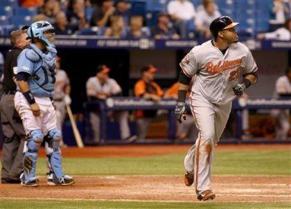 Nelson Cruz watches his two run home run during the eleventh inning. (Photo couretesy of Reinold Matay/AP Photo)