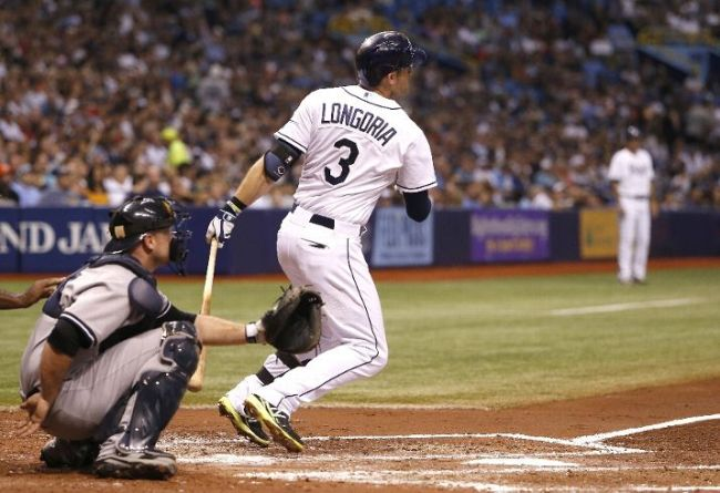 Evan Longoria hit a solo home run during the fourth inning of a game on September 17, 2014. (Photo courtesy of Brian Blanco/Getty Images)