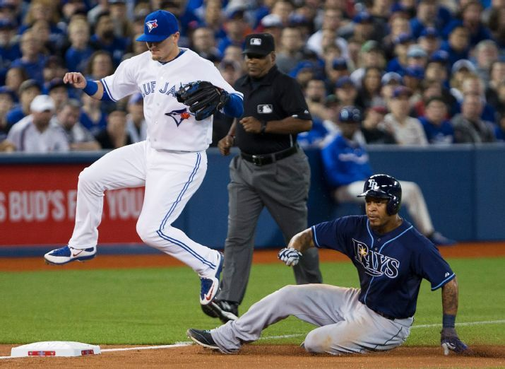 Desmond Jennings steals third base during the second inning. (Photo courtesy of Peter Power/The Canadian Press via AP)