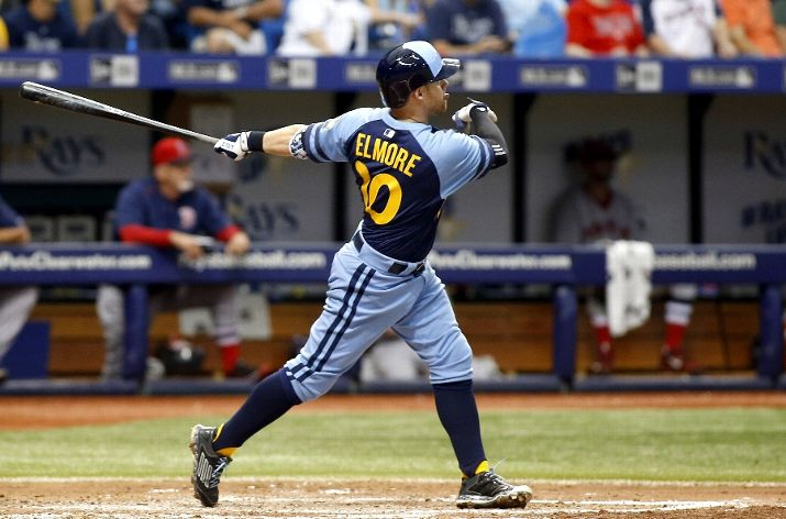 Jake Elmore #10 of the Tampa Bay Rays hits a two-run home run during the fifth inning of a game against the Boston Red Sox on June 27, 2015 at Tropicana Field in St. Petersburg, Florida. (Photo by Brian Blanco/Getty Images)