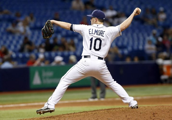 Infielder Jake Elmore pitches during the eighth inning last night. (Photo Credit: Brian Blanco/Getty Images)