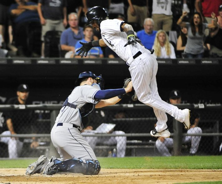 Alexei Ramirez is tagged out by Curt Casali during the ninth inning on August 3, 2015. (Photo by David Banks/Getty Images)