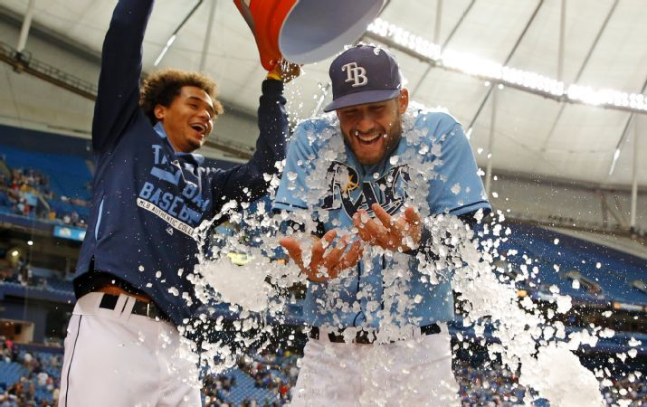 Kevin Kiermaier is doused with ice by Chris Archer to celebrate a 3-2 win over the Kansas City Royals on Sunday. (Photo Credit: AP Photo/Mike Carlson)