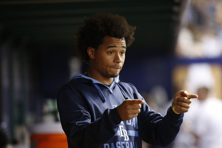 Chris Archer #22 of the Tampa Bay Rays gestures as he speaks with teammates in the dugout during the fifth inning of a game against the New York Mets on August 7, 2015 at Tropicana Field in St. Petersburg, Florida. (Photo by Brian Blanco/Getty Images)