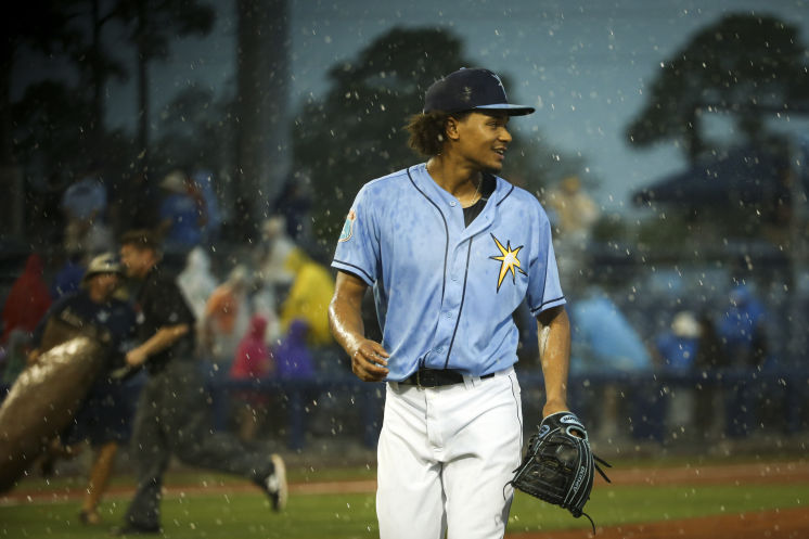 Rays starter Chris Archer heads off the field after getting two outs on six pitches in the first inning. The game is cancelled by rain, but Archer throws about 90 pitches in the batting cages. (Photo Credit: Will Vragovic/Tampa Bay Times)