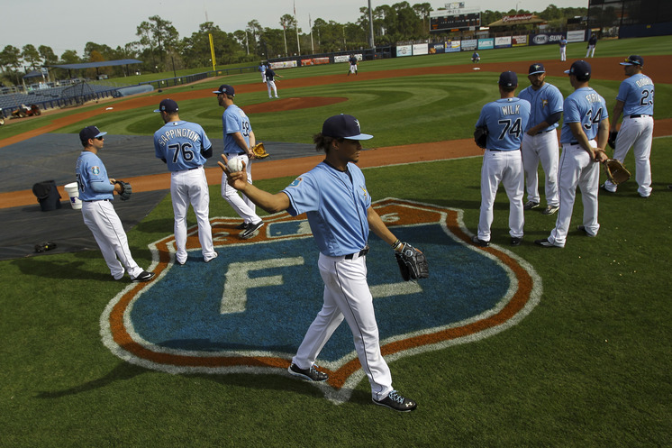 Rays starting pitcher Chris Archer and his teammates on the field before Thursday's game in Port Charlotte. (Photo Credit: Will Vragovic/Tampa Bay Times)