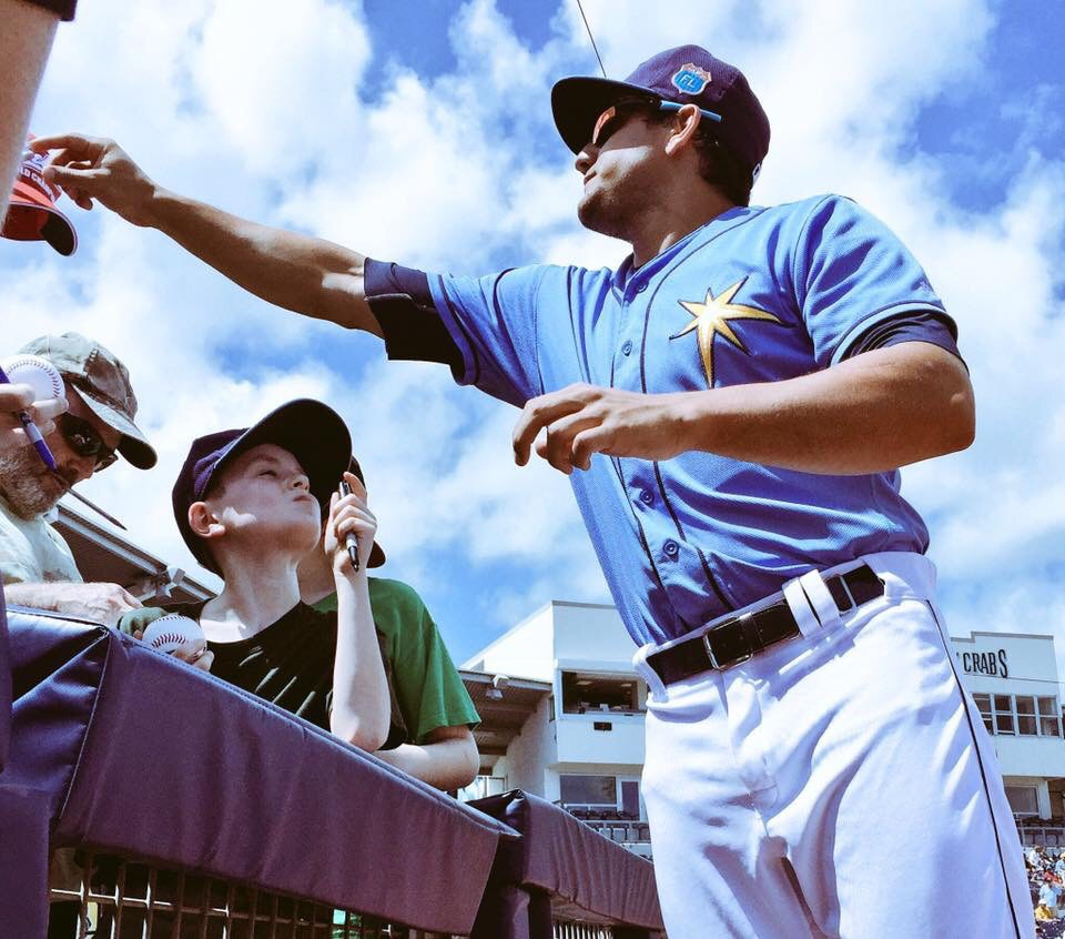 Outfielder Mikie Mahtook signs autographs for fans at Charlotte Sports Park for the last time this Spring. (Photo Credit: Tampa Bay Rays)