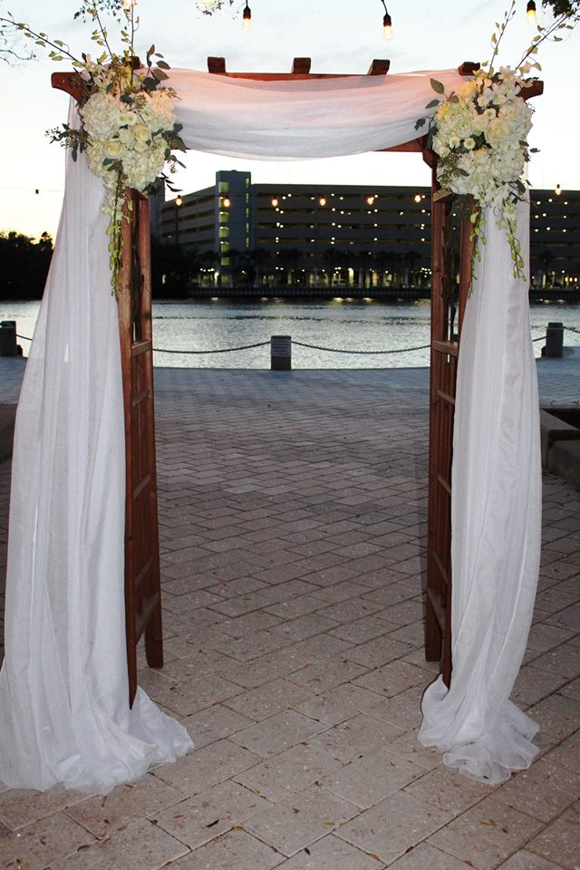 Weddings Ceremonies Arch with drape and fresh flowers