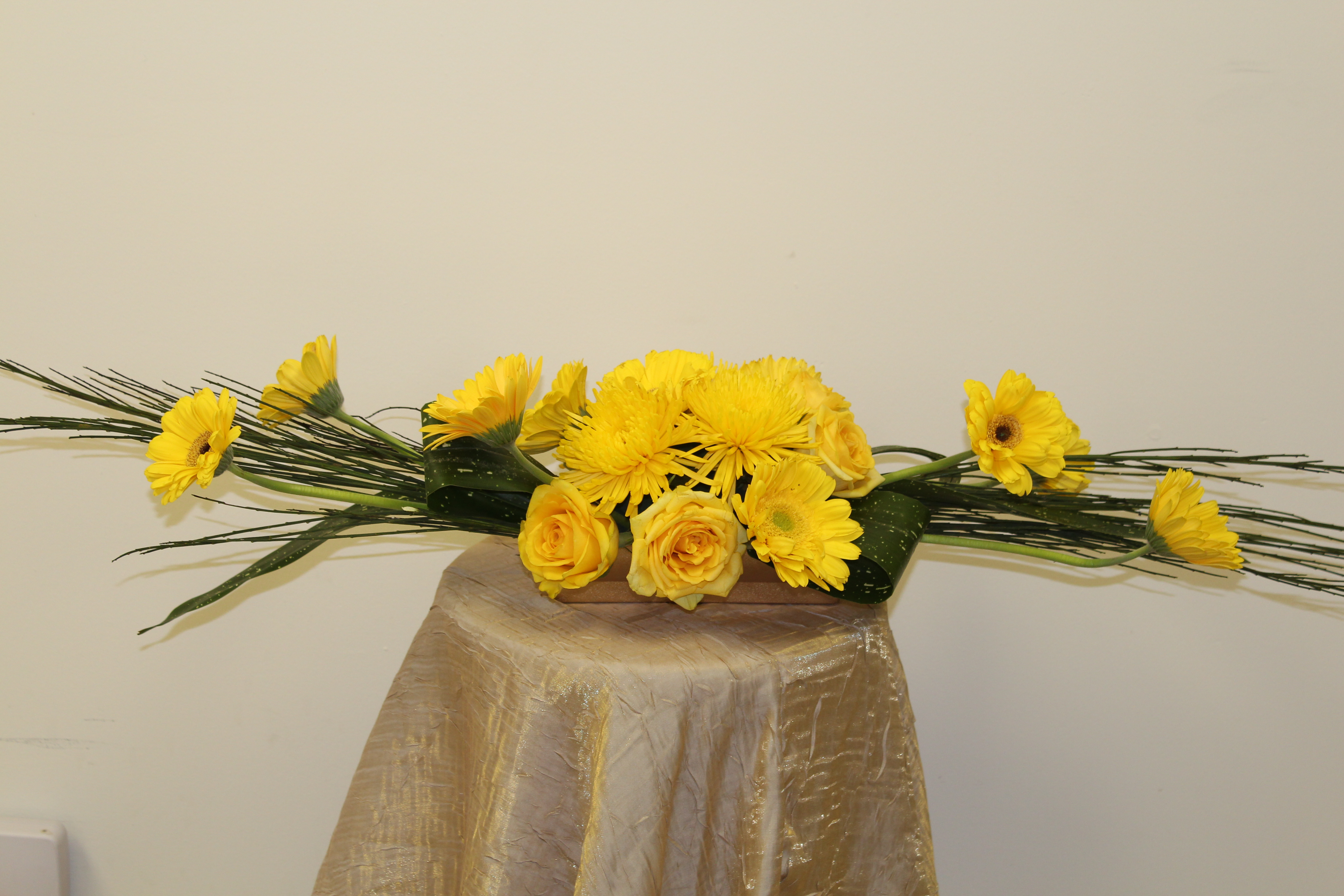 low and low yellow Gerber daisy& roses centerpiece