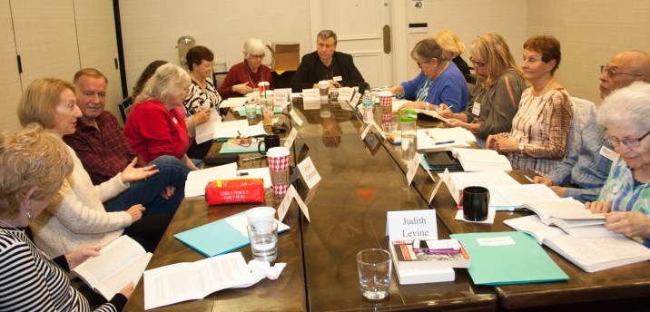 """TBGBC Chief Moderator Patrick DeMarco (top, at head of table) moderates the challenges of Franzen's """"The Corrections"""" - a dystopic family portrait . Clockwise from upper right, Catherine Wright Haddock (partially hidden), Amanda Putnam, Margaret Hoffman, Mark Simo, Edythe Shapiro, Joyce Simard, Joyce Carpenter, Malcolm Harris, Barbara Brown, Cheryl Walker, and Brenda Tipps."""